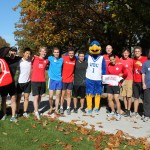Thunderbird and United Way mascot poses with some of the runners