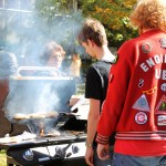 Sigma Phi Delta's barbeque smoke entices the now hungry runners